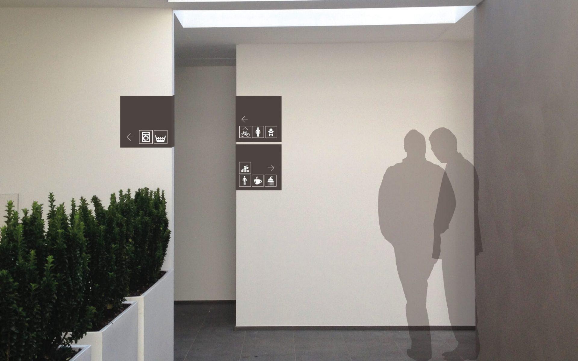 cartelli segnaletici in metallo coordinati alla immagine aziendale, progettati dallo studio grafico diade per verdepiano camping