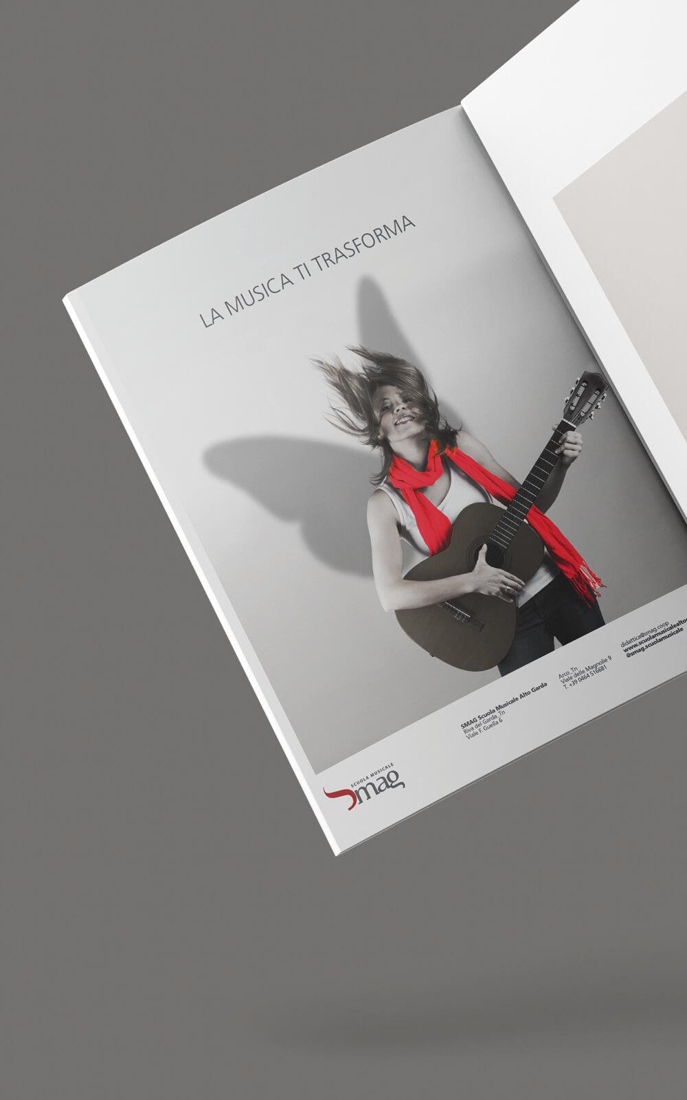 annuncio stampa creato per smag scuola musicale in occasioen dell'inaugurazione nuova sede, progettato dallo studio grafico diade arco trento
