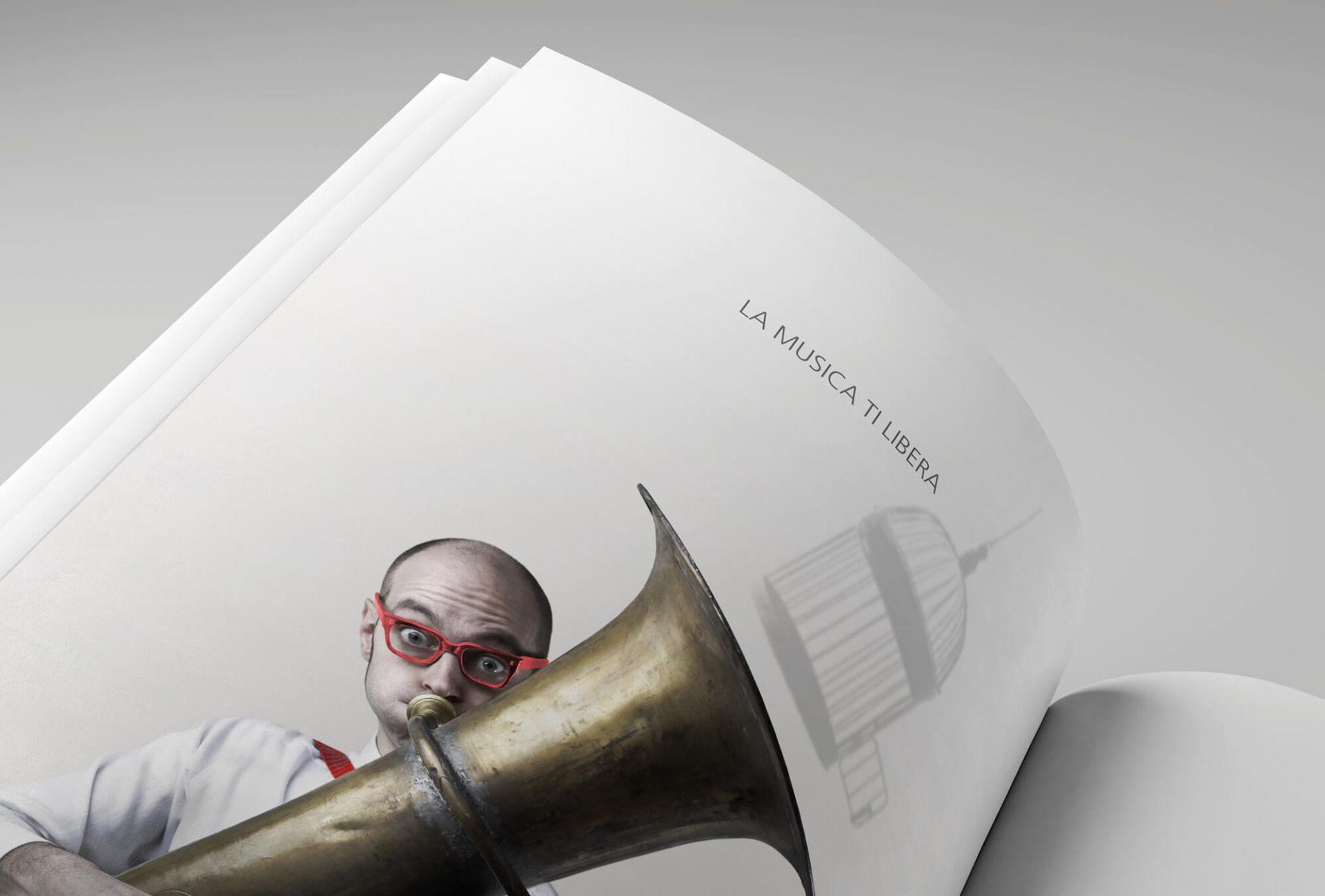 dettaglio annuncio pubblicitario della campagna stampa per l'inaugurazione della scuola musicale alto garda, adv creata dalla agenzia di pubblicità diade studio arco di trento