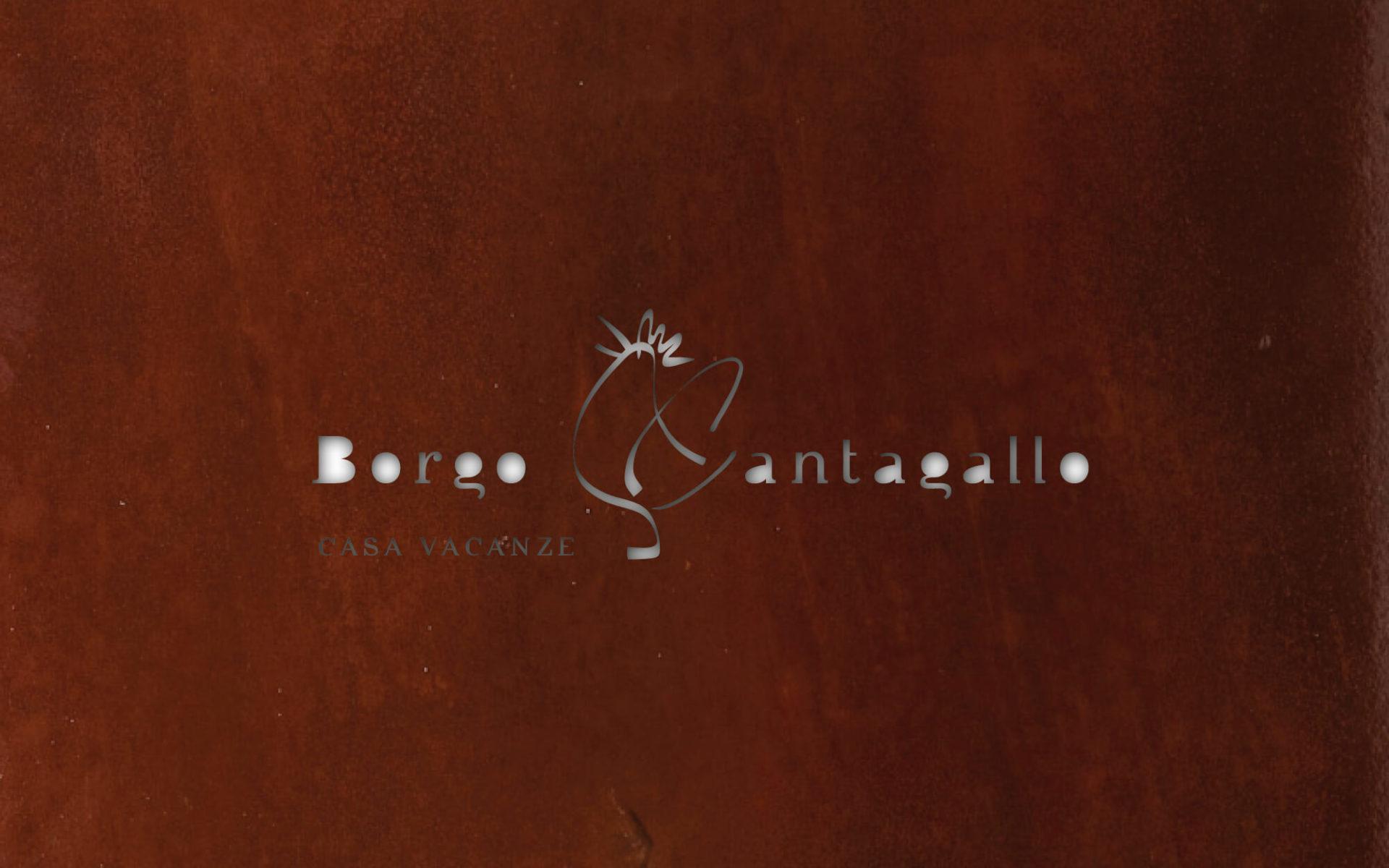 dettaglio del marchio intagliato nel corten, e dell'identità aziendale per Borgo Cantagallo. Dettaglio insegna in ferro corten. Progetto Diadestudio ArcoTn